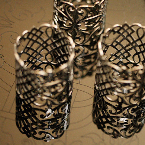 nickel silver plated with black rhodium - set of 4 arabesque napkin rings
