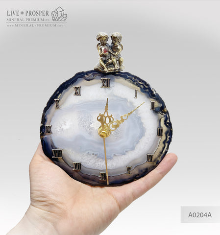 Clock with a bronze cupid figures with garnet heart on agate plate А0204A