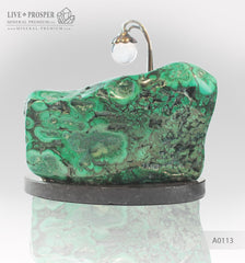 Bronze Cupid and Sweethearts with Malachite and Rock- crystal Sphere on a Dolerite plate