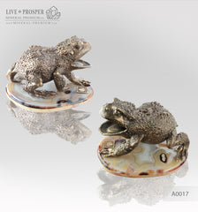 Bronze figure of frog with demantoids inserts on a marvel plate