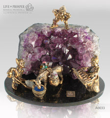 Bronze dwarf miners with a donkey figures at amethyst mine on dolerite plate