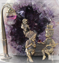 Bronze Figure of Sweethearts on a Bench  with Garnet heart