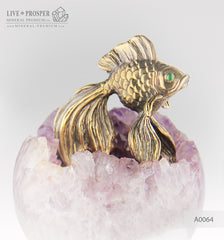 Bronze figure of goldfish with demontoids eyes  on amethyst agate geodes sphere on a  dolerite plate