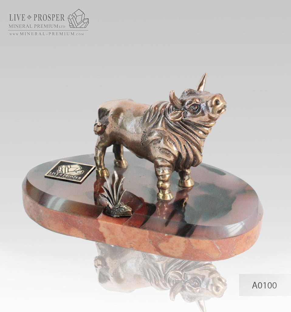 Bronze bull with bush on agate and marvel plate