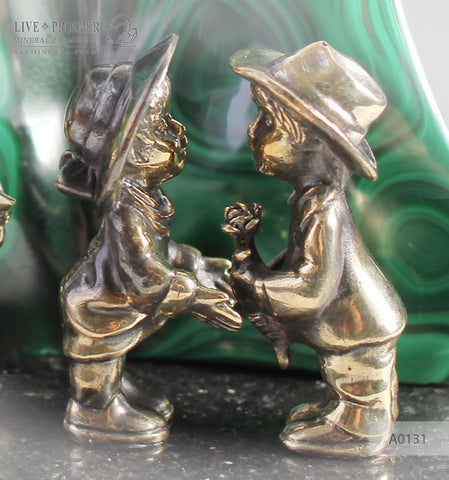 Bronze cupid and sweethearts with citrine sphere on a dolerite plate with malachite background A0131