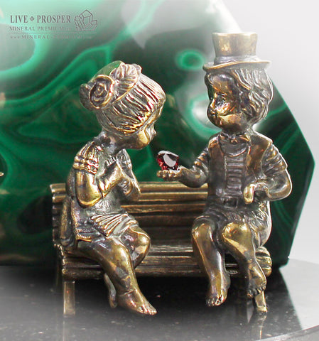 Bronze cupid and sweethearts with garnet heart and malachite background