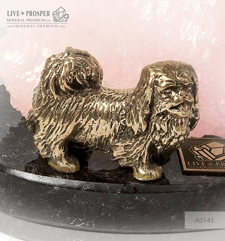 Bronze figure of a dog breed Pekingese with pink calcite on a dolerite plate