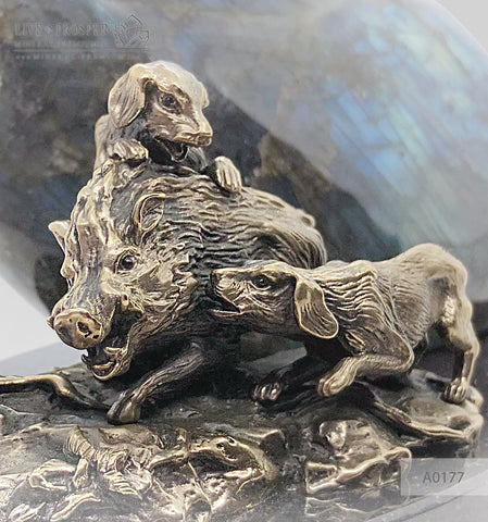 Bronze boar and dogs figures with labradorite on a dolerite plate