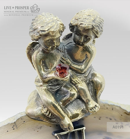 Clock with a bronze cupid figures with garnet heart on agate plate A0191