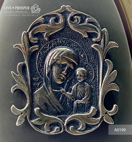 Bronze overlay of the icon figures of the Virgin Mary with jasper