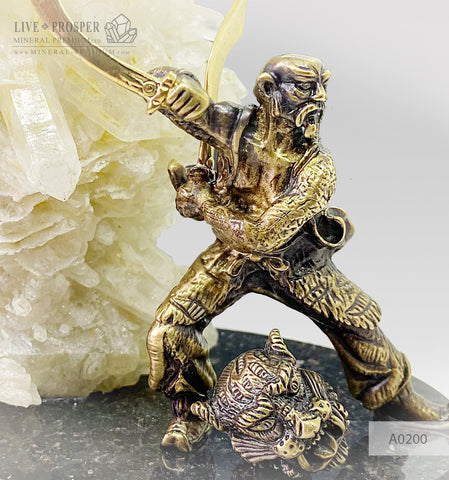 Bronze Samurai the Sky guardian with calcite on a dolerite plate and color led system  A0200