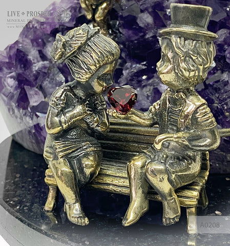 Bronze cupid and sweethearts with a garnet heart and rock-crystal sphere within bronze lantern with geode agate amethyst druzy background