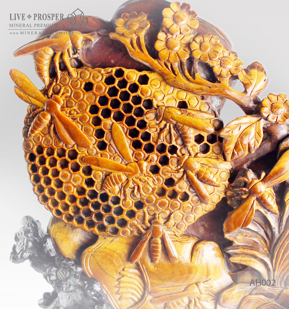 Solid tiger's eye carving of Honeybees with Flowers on a Wooden stand