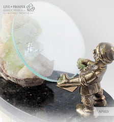 Bronze Dwarf figure with a Magnifying glass and Apophyllite