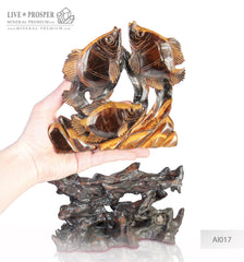 Tiger Eye carving of Fish family Playing under the Sea on a Wooden stand