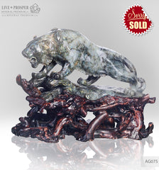 Solid labradorite Tiger carving on a wooden stand