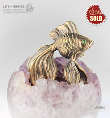 Bronze figure of Goldfish with Demontoids eyes on Amethyst sphere on a Dolerite plate