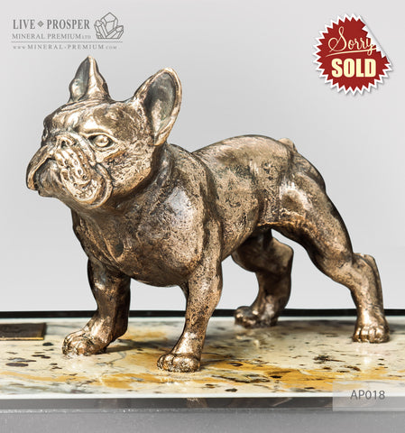 Bronze figure of a dog breed French Bulldog on jasper plate