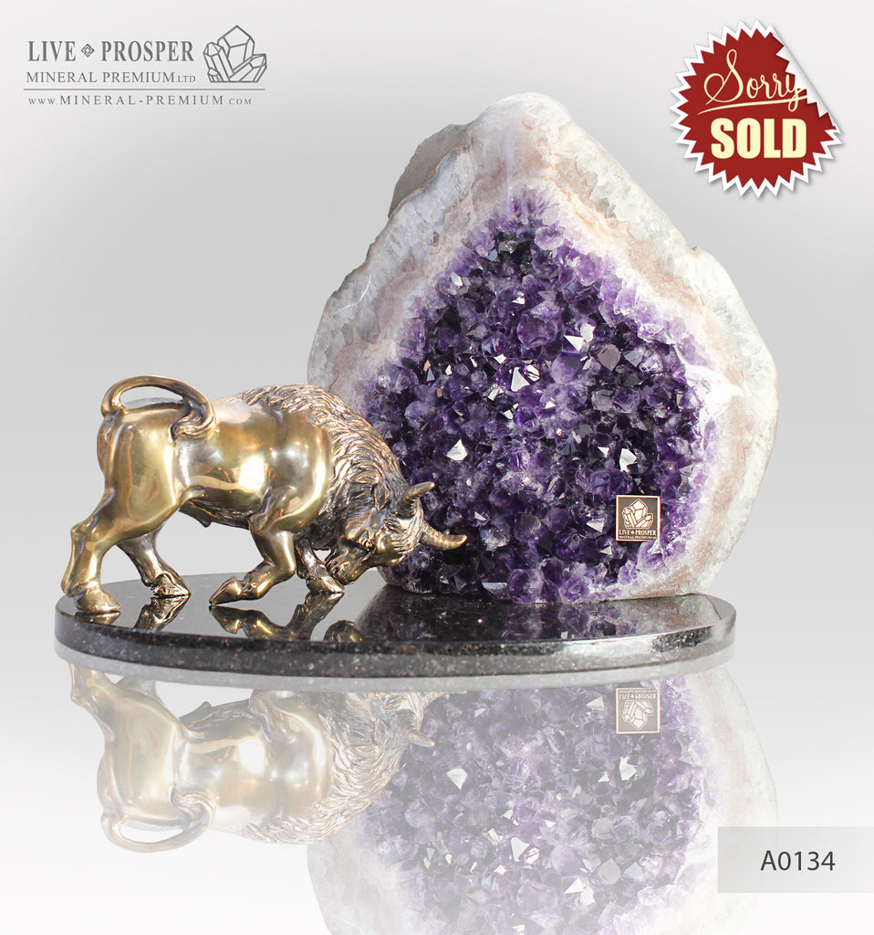 Bronze bull with agate geode amethyst on a dolerite plate
