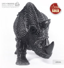 Solid obsidian carving of Rhino on guard  AR096