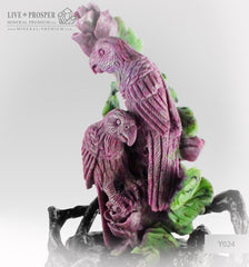 Solid  ruby zoisite carving of parrots couple with roses on a wooden stand