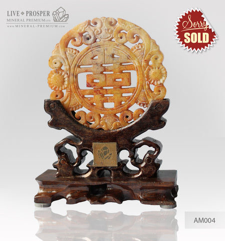 Jade Amulet on a wooden stand Tibetan Endless knot