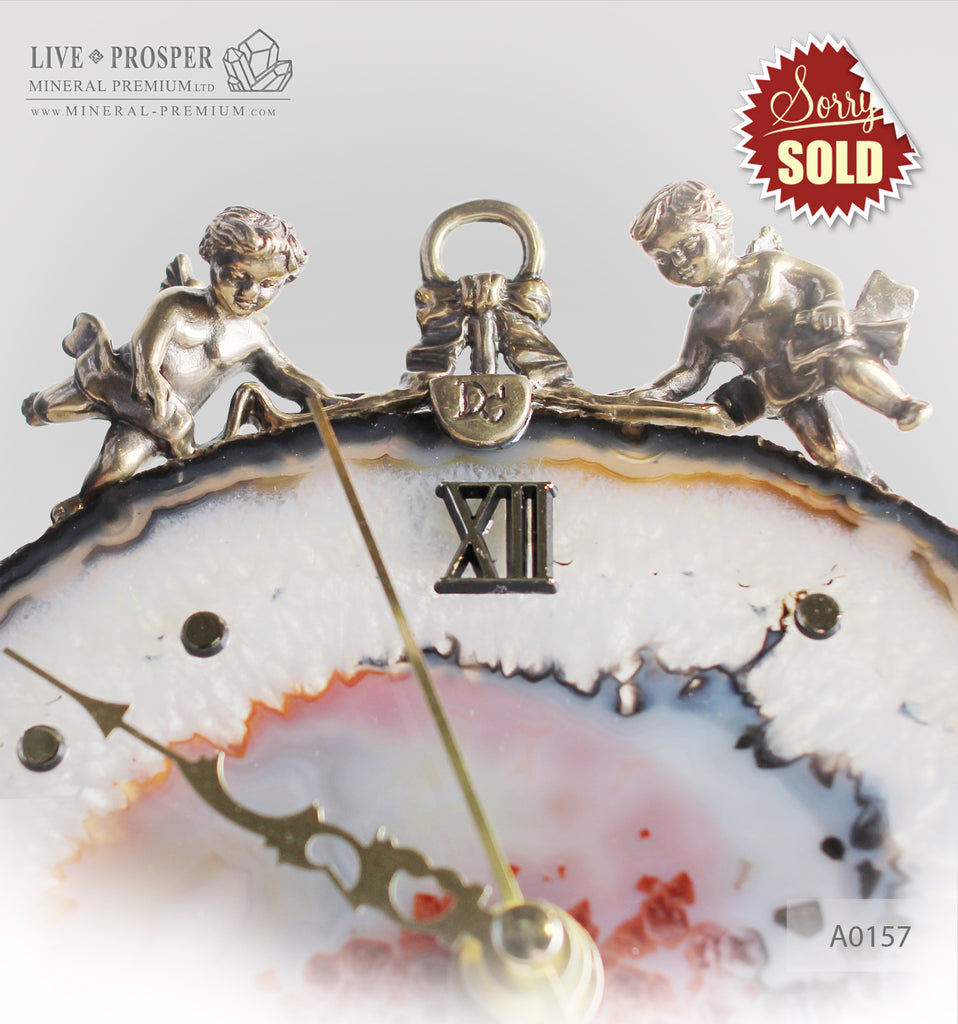 Clock with a bronze Cupid figures on agate plate  A0157