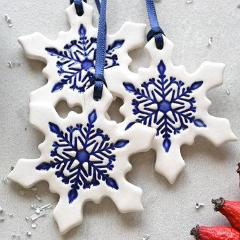 ceramic snowflake christmas decorations in blue and white