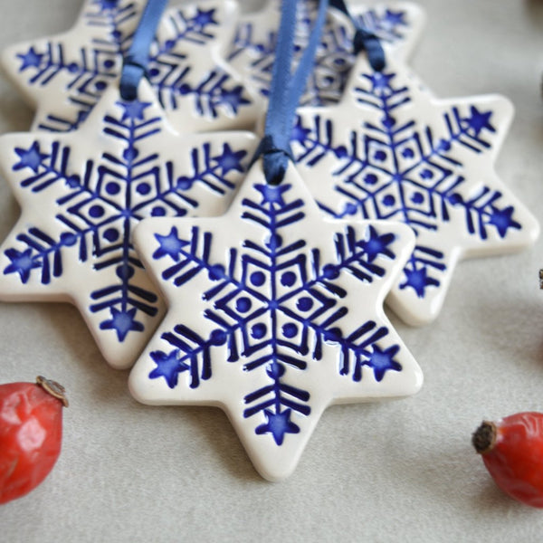ceramic star christmas ornaments in white and royal blue