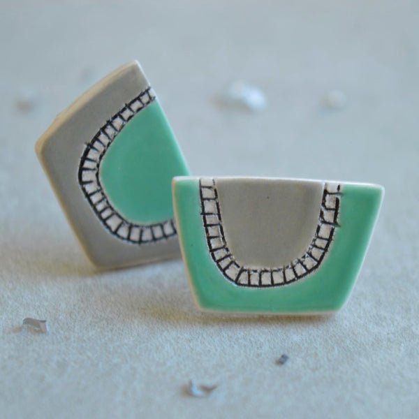 Mismatched turquoise and grey stud earrings