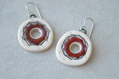 Red hole earrings