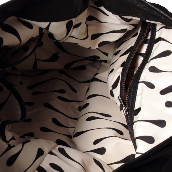 special tear-drop print-lined interior, 23cm zip and mobile phone pockets