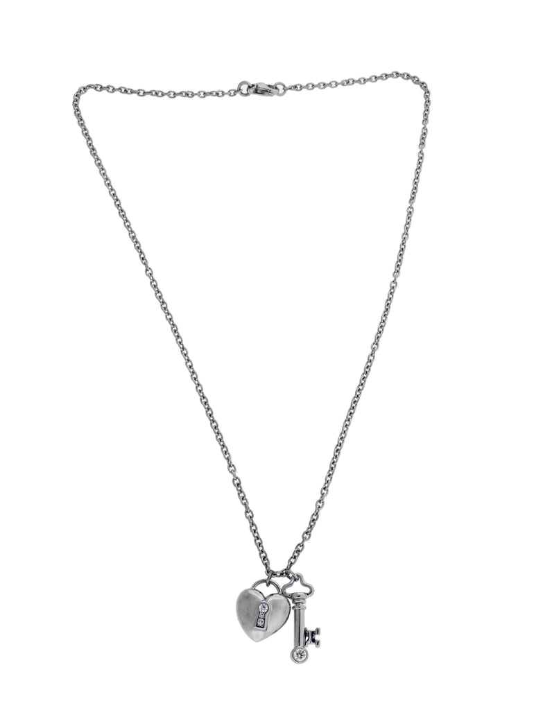 Tiffany & Co  Key & heart diamond pendant necklace in platinum used