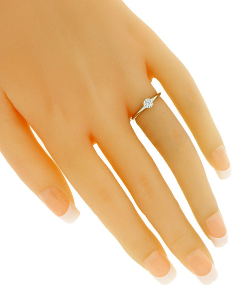 Tiffany & co .24 carat solitaire engagement ring in platinum, in new condition.