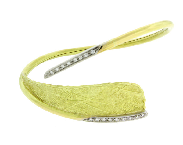 Unoaerre diamond flexible bangle in 18 karat yellow & white gold.