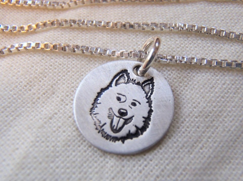 Samoyed necklace in sterling silver.  Hand crafted by drake designs jewelry
