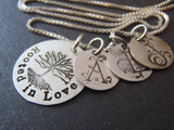 Mother's sterling silver necklace with personalized family initials. Rooted in Love family tree of life