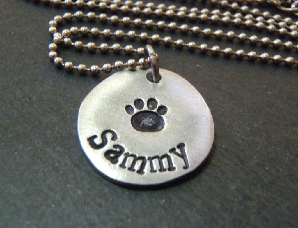 Personalized pet paw print necklace with pet's name hand stamped - Drake Designs Jewelry