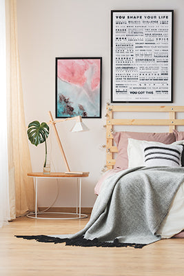 Modern bedroom with the Manifesto and Unlocal prints on the wall