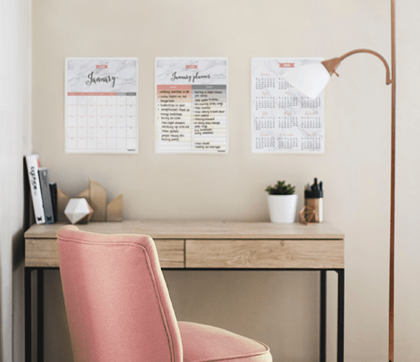 Gorgeous blush boho home office workspace with a free 2018 printable calendar in marble and blush displayed on the wall above the desk
