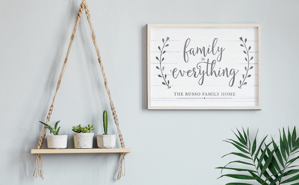 modern boho decor home with a framed Family Is Everything personalized print hanging on the wall