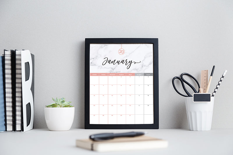 Modern black and white work space with a framed calendar printable