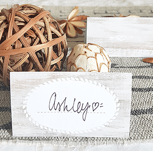 Free printable name tent card on a rustic Thanksgiving table