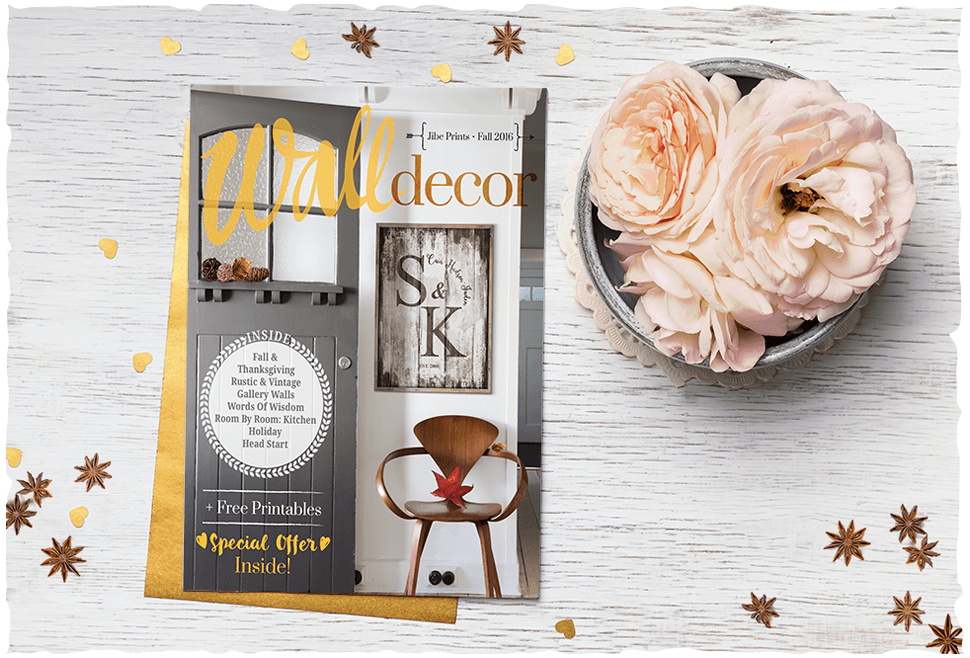 Wall Decor magazine Fall 2016 issue on a rustic desk with flowers