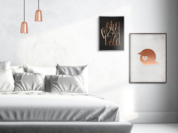 Picture of a bedroom with copper accents, Stay Wild poster and Copper Chirp poster on the wall