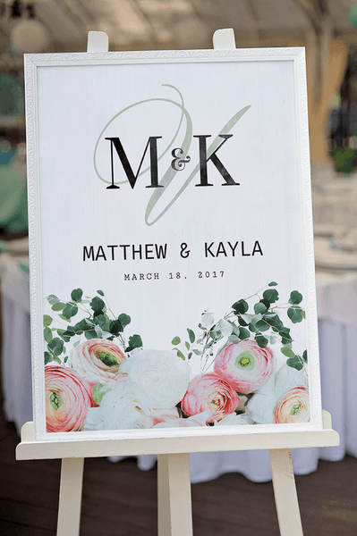 Bouquet personalized print framed on an easel at a wedding reception