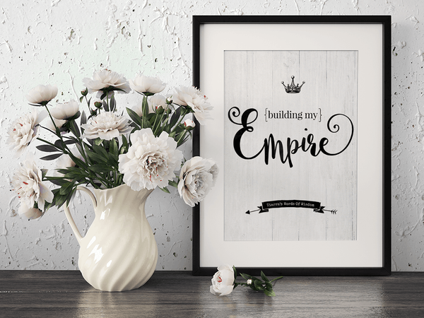 Desk with a framed Building My Empire personalized print