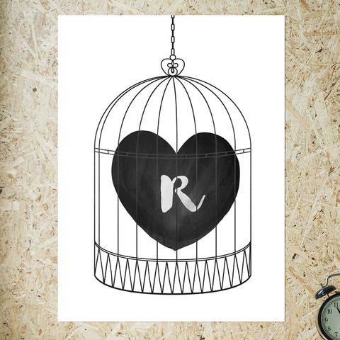 watercolor heart in a bird cage. have an initial set in the heart. black and white print