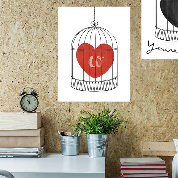 Teenager's room with our print with a watercolor red heart in a bird cage. have an initial set in the heart.
