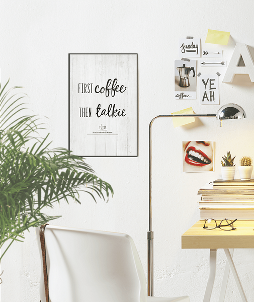 modern chic workspace with a First Coffee Then Talkie print framed on the wall